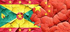 Grenada flag with China flag on a grunge cracked wall - stock illustration