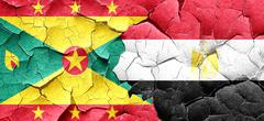 Grenada flag with egypt flag on a grunge cracked wall - stock illustration