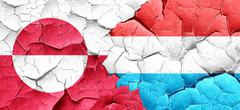 greenland flag with Luxembourg flag on a grunge cracked wall - stock illustration