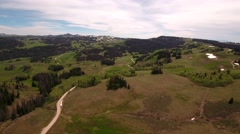 Aerial panning shot of a high mountain pass in the spring Stock Footage