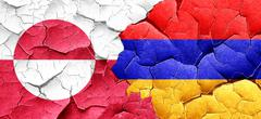 greenland flag with Armenia flag on a grunge cracked wall - stock illustration