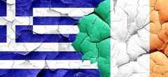 Greece flag with Ireland flag on a grunge cracked wall - stock illustration