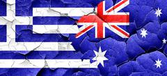 Greece flag with Australia flag on a grunge cracked wall Stock Illustration