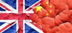 Great britain flag with China flag on a grunge cracked wall - stock illustration