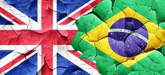 Great britain flag with Brazil flag on a grunge cracked wall Stock Illustration