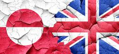 greenland flag with Great Britain flag on a grunge cracked wall - stock illustration