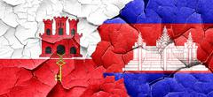 Gibraltar flag with Cambodia flag on a grunge cracked wall Stock Illustration