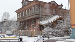 The wooden house in the snow. Arkhangelsk Stock Footage