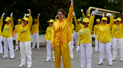 Falun Gong makes gymnastics in the square on Festival Coquitlam Grand Parade Stock Footage