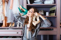 Woman searching for clothing in a closet - stock photo