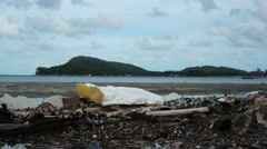 Pollution on the beach of tropical island - stock footage