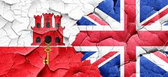 gibraltar flag with Great Britain flag on a grunge cracked wall - stock illustration