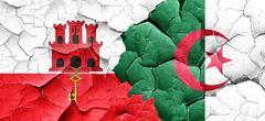 gibraltar flag with Algeria flag on a grunge cracked wall - stock illustration