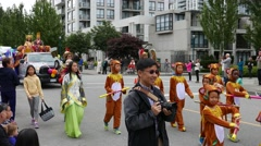 Tri-city Chinese Canadian association parading the street - stock footage
