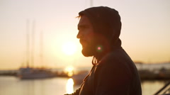 Young handsome man near sea. Slow motion - stock footage