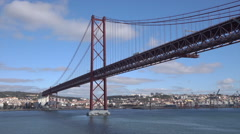 Lisbon, Lorry crosses the 25 of April bridge, Tagus River, Portugal - stock footage