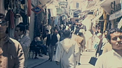 Morocco 1970: people walking in an outdoor market - stock footage