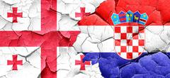 Georgia flag with Croatia flag on a grunge cracked wall - stock illustration