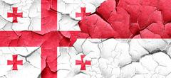 Georgia flag with Indonesia flag on a grunge cracked wall - stock illustration