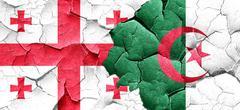 Georgia flag with Algeria flag on a grunge cracked wall - stock illustration