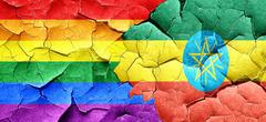 Gay pride flag with Ethiopia flag on a grunge cracked wall Stock Illustration