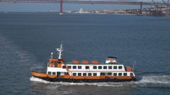 Lisbon Cacilhas ferry with bridge behind Tegus River, Portugal Stock Footage