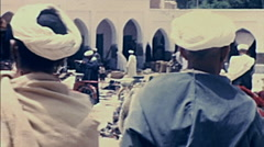Morocco 1970: people in an outdoor market Stock Footage