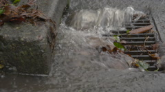 A storm drain with a large amount of water rushing into it Stock Footage