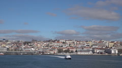 Modern Lisbon ferry crosses Tegus River, Portugal Stock Footage