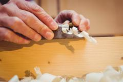 Close-up of wood shavings being pulled out Stock Photos