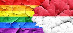 Gay pride flag with Indonesia flag on a grunge cracked wall Stock Illustration
