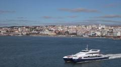 Modern Lisbon ferry with bridge behind Tegus River, Portugal Stock Footage