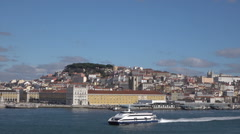 Modern Lisbon ferry passes old city buildings, Portugal Stock Footage