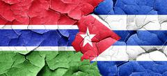 Gambia flag with cuba flag on a grunge cracked wall - stock illustration