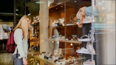Shopping - young tourist woman looking in a shop window Stock Footage