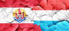 French polynesia flag with Luxembourg flag on a grunge cracked w Stock Illustration