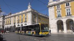 Lisbon public bus passes Commercial Square, Rua Augusta Arch, Portugal Stock Footage