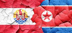 French polynesia flag with North Korea flag on a grunge cracked Stock Illustration