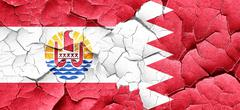 French polynesia flag with Bahrain flag on a grunge cracked wall Stock Illustration