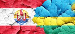 french polynesia flag with rwanda flag on a grunge cracked wall - stock illustration
