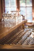 Empty wine glasses arranged on bar counter at bar Stock Photos
