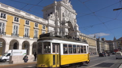 Lisbon public tram passes Commercial Square, Rua Augusta Arch, Portugal Stock Footage
