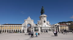 Lisbon, people visit Commercial Square and horse statue, Portugal Stock Footage