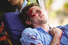 Close-up of an injured man lying on a stretcher Stock Photos