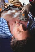Injured man receiving help with a defibrillator Kuvituskuvat