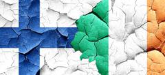 Finland flag with Ireland flag on a grunge cracked wall Piirros