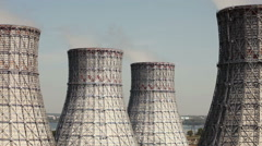The cooling system of a nuclear reactor. Four cooling towers - stock footage