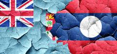 Fiji flag with Laos flag on a grunge cracked wall - stock illustration
