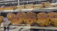 Lisbon, traditional bread rolls in cafe shop window, Portugal Stock Footage