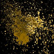 Vector gold paint splash, splatter, and blob shiny on black background. Glowing - stock illustration